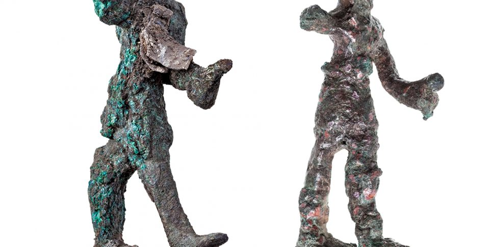 The two 'smiting god' figurines
